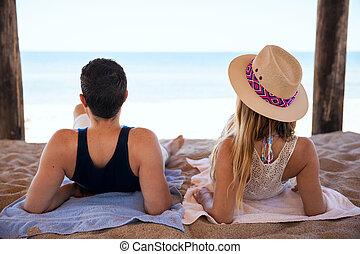 Honeymooners relaxing at the beach