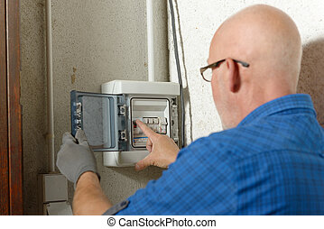 mature man working with electric box at house