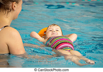 mother and daughter in the pool - mother and little daughter...