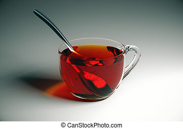 Tea on grey table - Transparent cup of tea with spoon on...