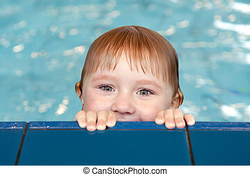 little child in swimming pool - the little child in swimming...