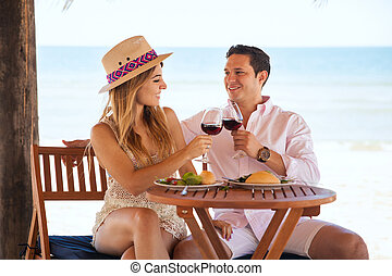 Couple celebrating their anniversary at the beach -...