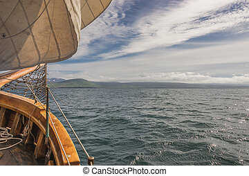 Sailing on the old boat towards adventures, summer time