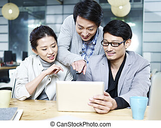 young asian business team working together in office - a...