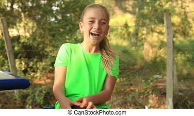 Adorable young girl laughing - Portrait Of Laughing Young...