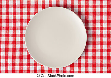 plate on checkered table cloth - the plate on checkered...