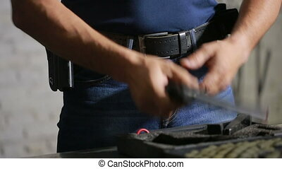 a man preparing to shoot a gun puts the gun in the holster...