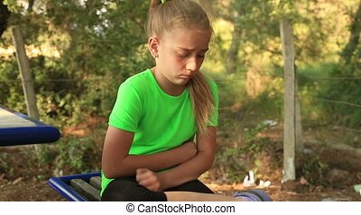 Sad young girl - Young girl with abdominal pain