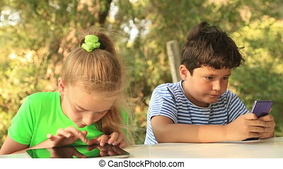 Kids with digital tablet - Closeup outdoor portrait of a...