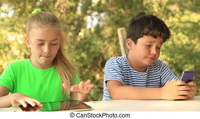 Young boy and girl with digital tablet - Happy young boy and...