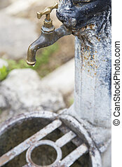 Closeup of iron faucet closed, with one drop of water - Iron...