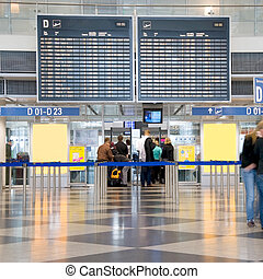 airport check-in - travellers queuing for the security check...