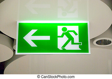 green emergency exit sign in a station