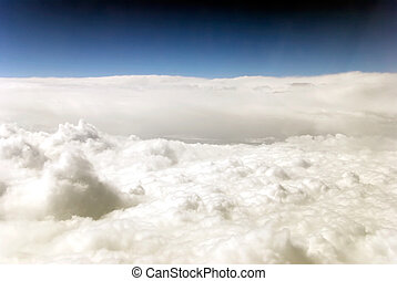 aerial photo from clouds and deep blue sky