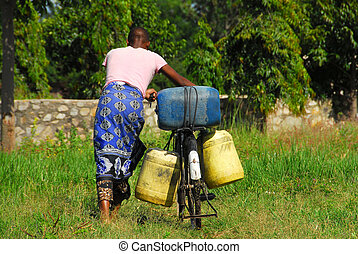 African woman with cans of water