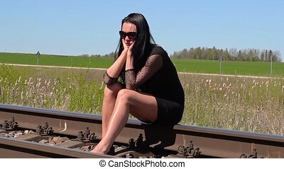 Depressed Woman sitting on railway