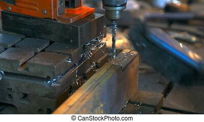 Metal drilling closeup in metal workshop Drilling machine...