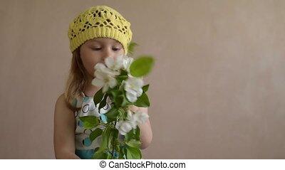 Girl throwing a little flower