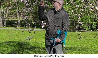 Disabled man with crutches enjoy nature