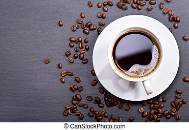 cup of coffee with beans