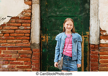 Outdoor portrait of fashion little girl of 7-8 years old,...