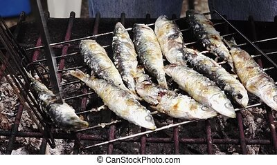 Cooking Sardines Fish on Barbeque
