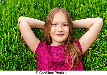Young little girl resting outdoors Close up outdoor portrait...