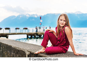 Fashion stylish portrait of pretty preteen girl of 8-9 years...