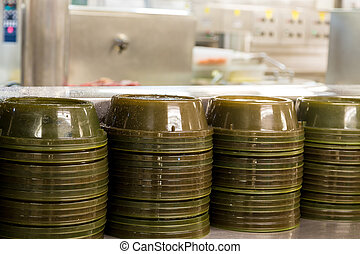 Green Serving Domes in Commercial Kitchen - Serving domes on...