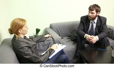 female director talking with the employee report to the...