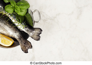 Raw rainbow trout with lemon, herbs and spices