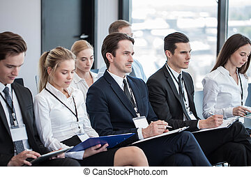 Business people making notes - Business group of people...
