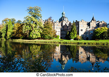 Castle Bueckeburg reflecting in the moat, Lower Saxony, on...