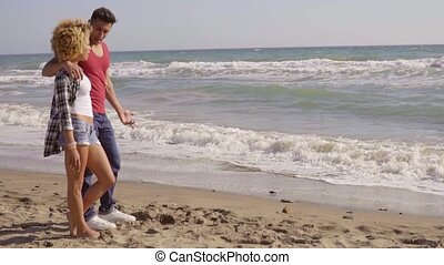 Young Couple On The Beach - Young couple in love standing on...
