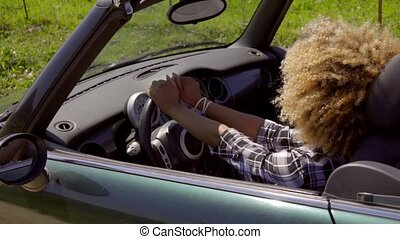 Young Black Sexy Lady Driving The Car - Young afro-american...