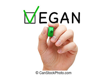 Vegan Check Mark Concept - Hand putting check mark with...