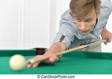 man playing billiards in  billiard club