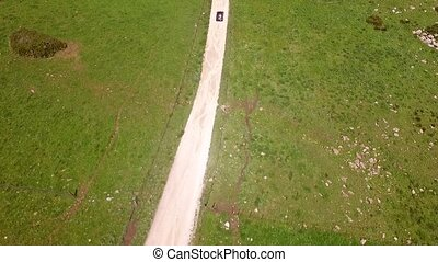 Aerial Of The Hilly Road With Driving Lonely Car - The...