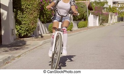 Young Exotic Woman Riding The Bicycle - Young woman dressed...