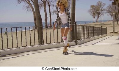 Woman Riding On Vintage Roller Skates. - Young sexy black...