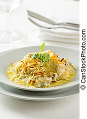 Sea bass in a saffron sauce with grated cheese gratin