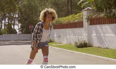 Girl Skates On Roller Skates. - Young woman dressed in plaid...