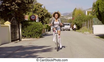 Young Woman Riding The Bicycle On The Road - Young...