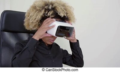 Pretty black woman with virtual reality glasses - Pretty...