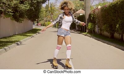 Black Woman Skating Down Mediterranean Street - Young exotic...