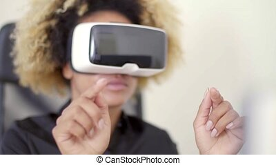 Businesswoman Working In Virtual Reality In Office - Young...