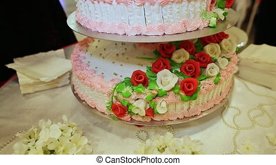 Sweet tiered wedding cake.