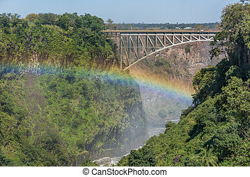 Close-up of Victoria Falls Bridge over rainbow