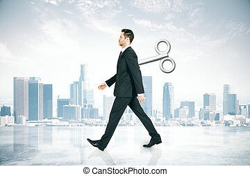 Walking businessman with wind-up key - Walking businessman...