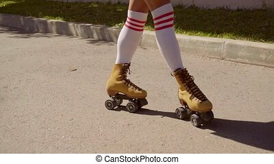 Female Legs On Vintage Roller Skater On The Road. - Close-up...